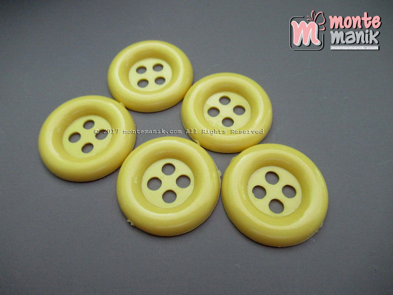 Kancing Plastik Kuning 2,5 CM (KPK-03)
